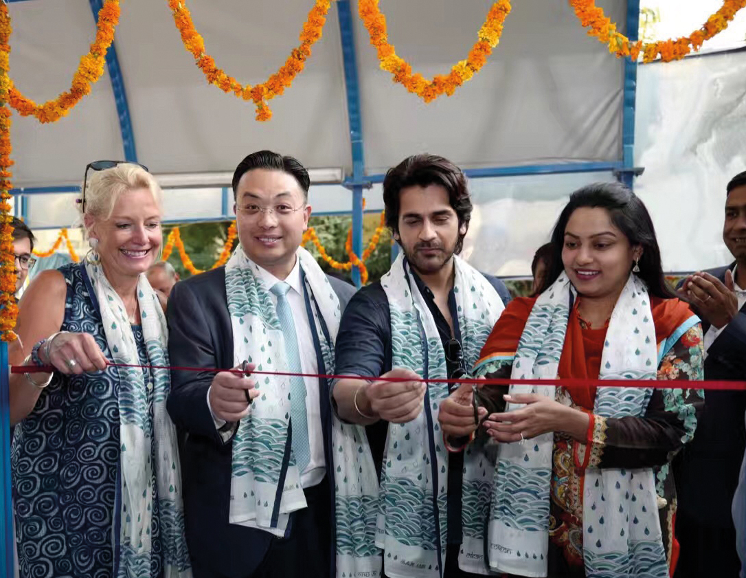 A project close to Dr Hon's heart has been opening a water purification plant in New Delhi, India